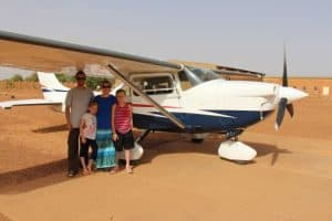 Penney family next to bush plane