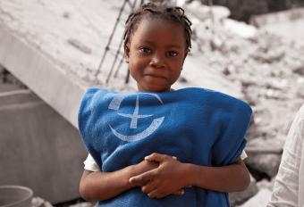 Girl holding blanket