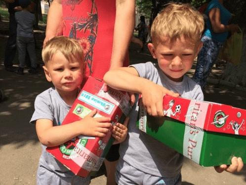 Children in Ukraine with shoeboxes
